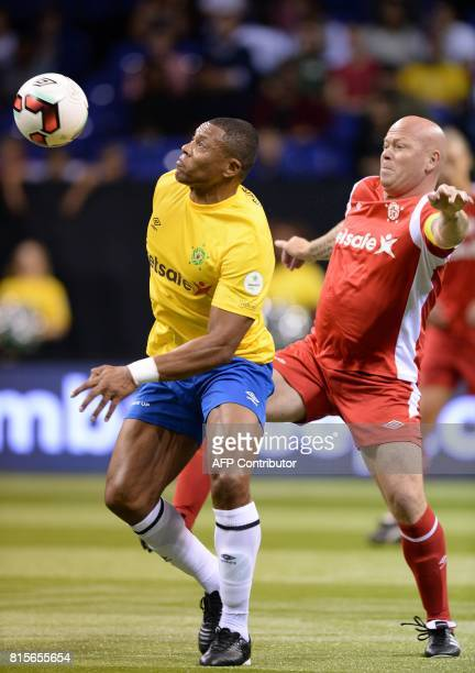 Brazil's Julio Baptista vies with Denmark's Stig Tofting during the Star Sixes semifinal football match between Denmark and Brazil at the O2 Arena in...