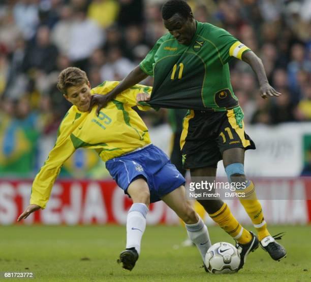 Brazil's Juninho Paulista and Jamaica's Theodore Whitmore