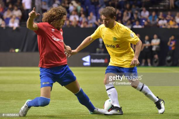 Brazil's Juninho vies with Spain's Carles Puyol during the Star Sixes 3rd place playoff football match between Spain and Brazil at the O2 Arena in...