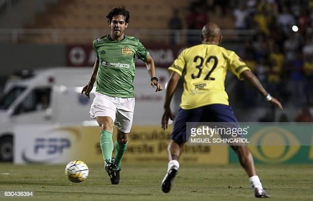 Brazil's Kaka of the US team Orlando City vies for the ball during the charity football match Ousadia vs Pedalada at Pacaembu stadium in Sao Paulo on...