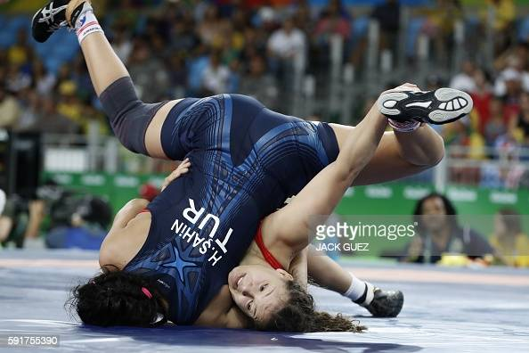 TOPSHOT Brazil's Lais Nunes de Oliveira competes with Turkey's Hafize Sahin during the women's wrestling 63kg qualifications at the Rio 2016 Olympic...