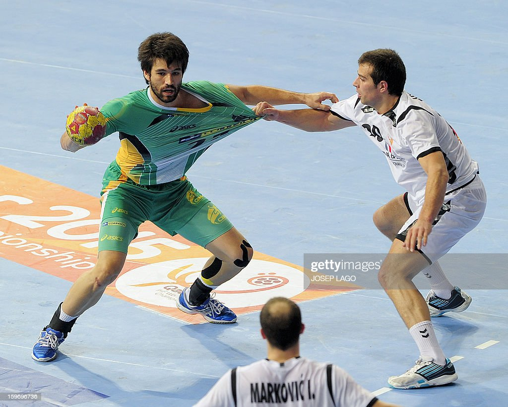 Brazil's left back Gustavo Cardoso (L) vies with Montenegro's centre back Stevan Vujovic (R) during the 23rd Men's Handball World Championships preliminary round Group A match Montenegro vs Brazil at the Palau Sant Jordi in Barcelona on January 18, 2013.