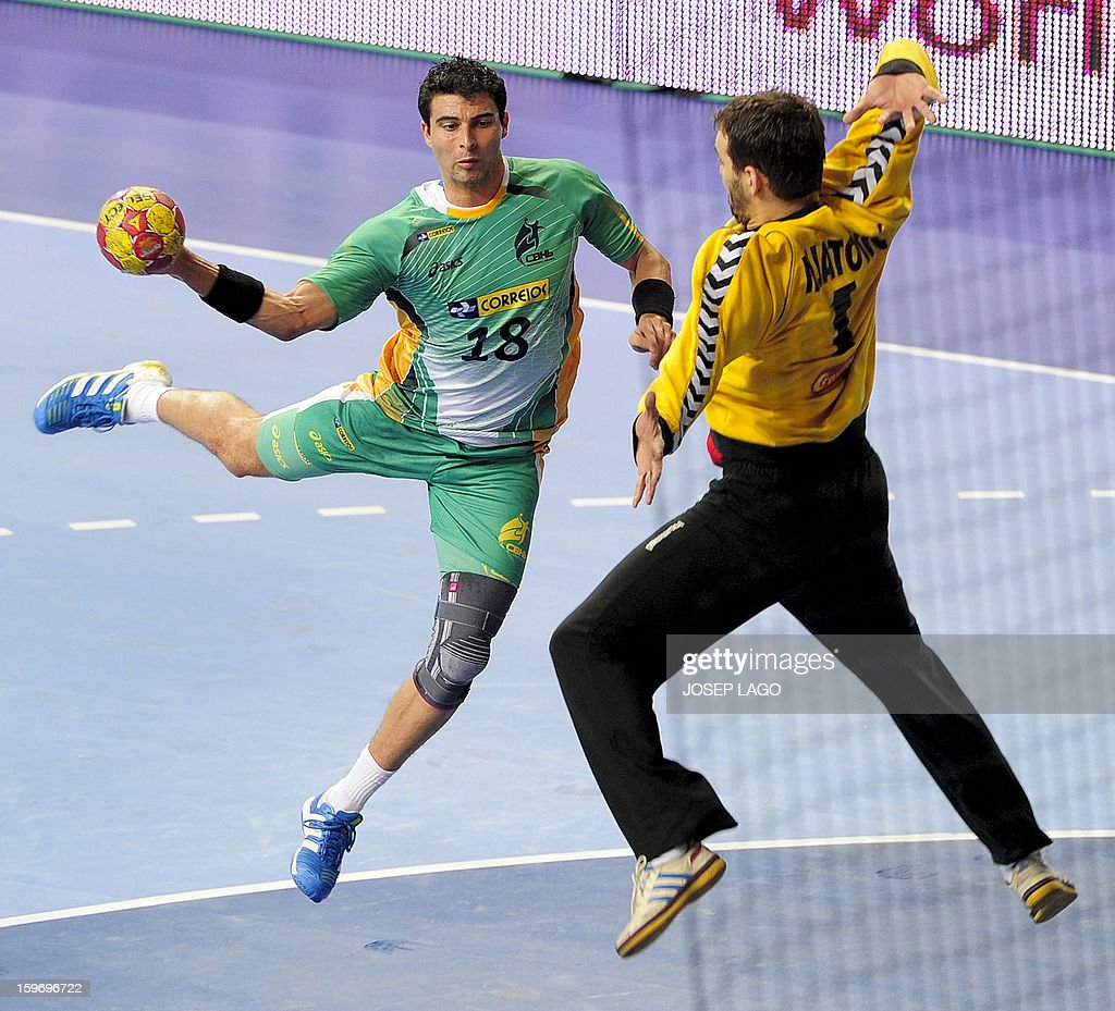 Brazil's left wing Felipe Ribeiro (L) vies with Montenegro's goalkeeper Rade Mijatovic (R) during the 23rd Men's Handball World Championships preliminary round Group A match Montenegro vs Brazil at the Palau Sant Jordi in Barcelona on January 18, 2013. AFP PHOTO/ JOSEP LAGO