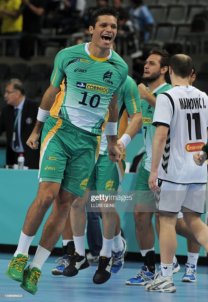 Brazil's left wing Gil Vicente Pires celebrates after winning the 23rd Men's Handball World Championships preliminary round Group A match Montenegro vs Brazil at the Palau Sant Jordi in Barcelona on January 18, 2013. Brazil won 26-25.