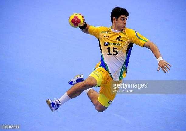 Brazil's leftback Arthur Patrianova jumps to score during the 23rd Men's Handball World Championships preliminary round Group A match Brazil vs...