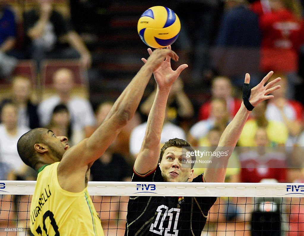 Brazil's Luciarelli Ricardo attacks German's defense Lukas Kampa during the FIVB World Championships match between Brazil and Germany on September 1, 2014 in Katowice, Poland.