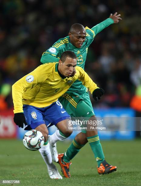 Brazil's Luis Fabiano and South Africa's Kagisho Evidence Dikgacoi battle for the ball