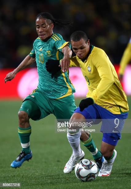 Brazil's Luis Fabiano and South Africa's Steven Pienaar battle for the ball