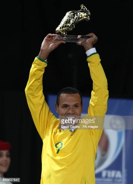 Brazil's Luis Fabiano celebrates with the golden boot after the Confederations Cup Final