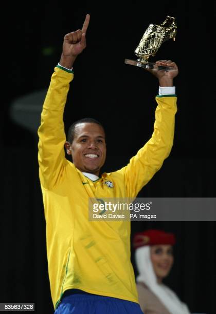 Brazil's Luis Fabiano celebrates with the Golden Boot Trophy after winning the Confederations Cup Final