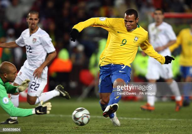Brazil's Luis Fabiano has a shot on goal saved by USA goalkeeper Tim Howard