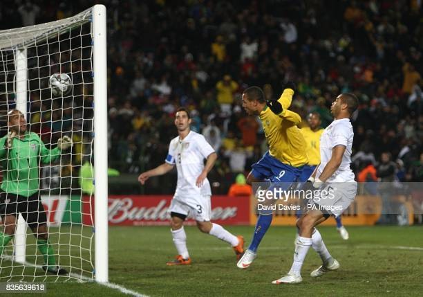 Brazil's Luis Fabiano heads in the equaliser past USA's goalkeeper Tim Howard