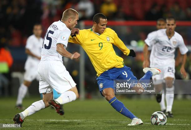 Brazil's Luis Fabiano scores their first goal past USA's Jay DeMerit