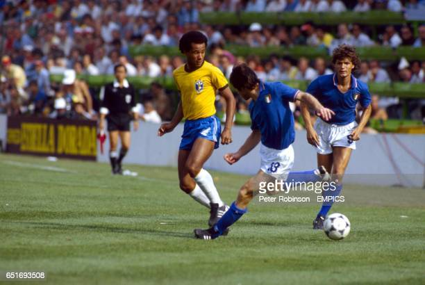 Brazil's Luisinho plays the ball past Italy's Gabriele Oriali watched by Italy's Giancarlo Antognoni