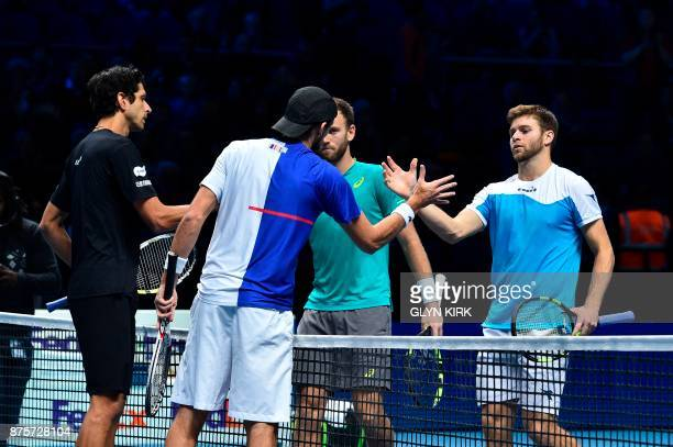 Brazil's Marcelo Melo and his partner Poland's Lukasz Kubot shake hands at the net with US player Ryan Harrison and New Zealand's Michael Venus after...
