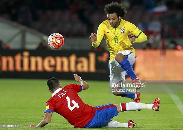 Brazil's Marcelo vies for the ball with Chile's Mauricio Isla during their Russia 2018 FIFA World Cup qualifiers match at the Nacional stadium in...