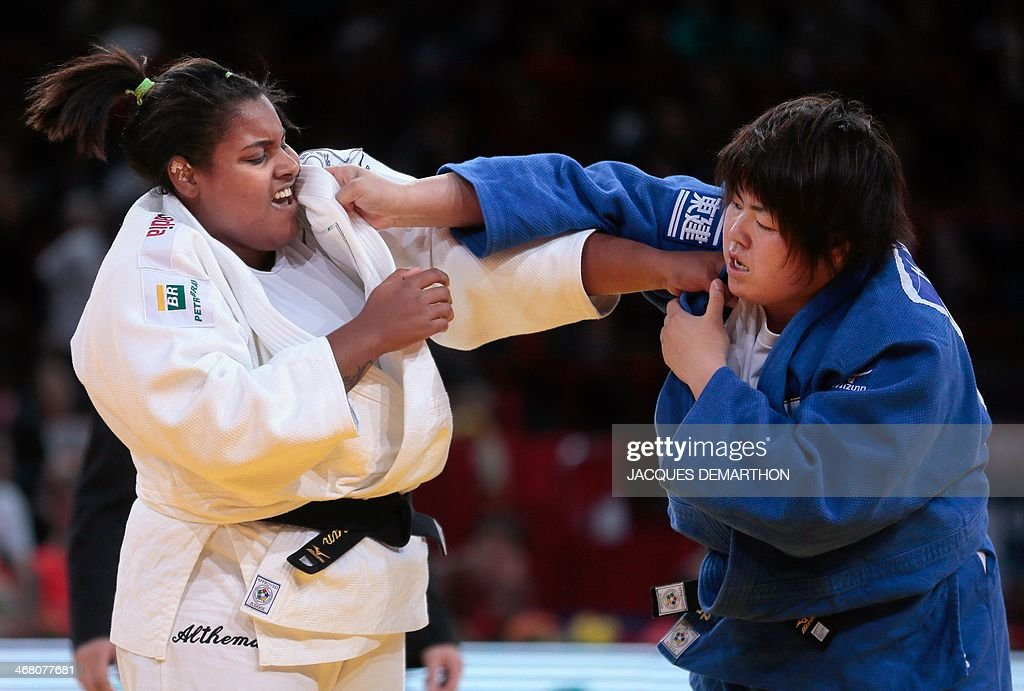 Brazil's Maria Suelen Altheman grapples with Japan's Yamabe Kanae during the women's 78kg semifinals at the 2014 Paris Judo Grand Slam tournament on...