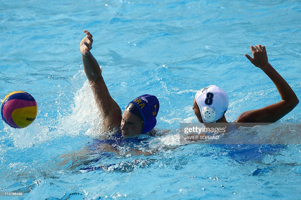Brazil's Marina Zablith (L) vies with Kazakhstan's Yekaterina Glusshkova (R) during the preliminary round match between Kazakhstan and Brazil of the women's water polo competition at the FINA World Championships in Bernat Picornell pools in Barcelona on July 23, 2013. AFP PHOTO / JAVIER SORIANO