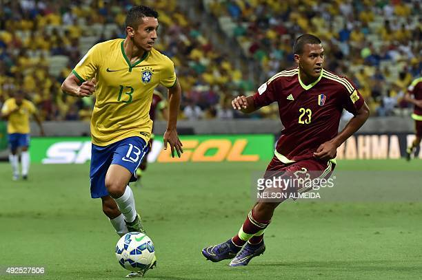 Brazil's Marquinhos and Venezuela's Jose Rondon vie for the ball during their Russia 2018 FIFA World Cup South American Qualifiers football match at...