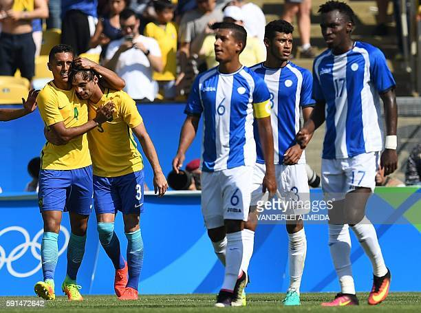 Brazil's Marquinhos celebrates with teammate Rodrigo Caio after scoring the 4th goal of his team against Honduras during their Rio 2016 Olympic Games...