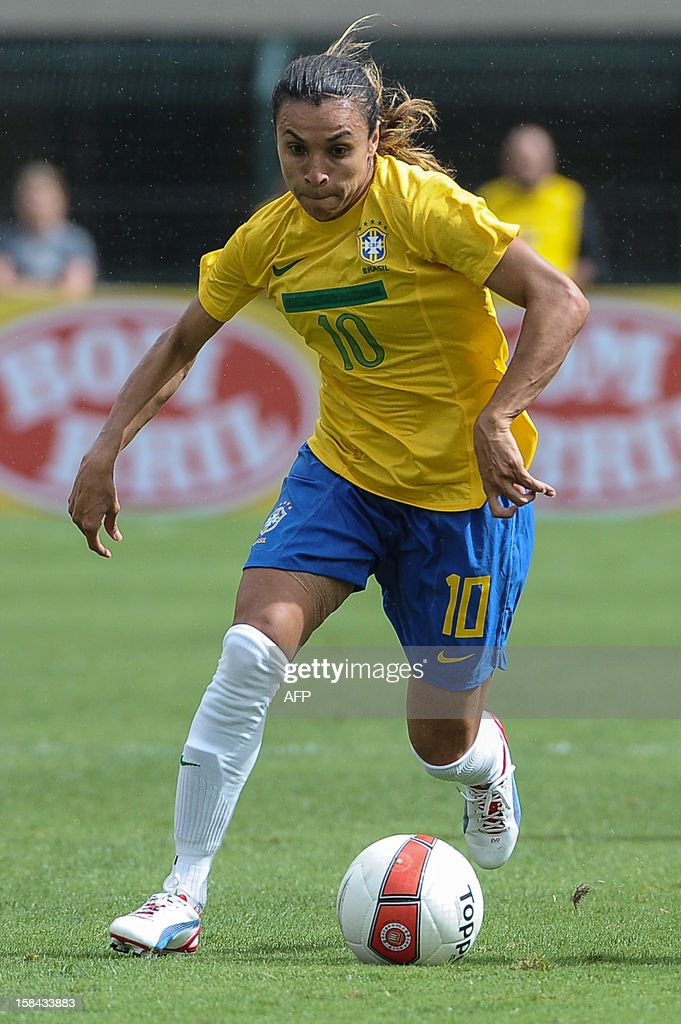 Brazil's Marta controls the ball during their City of Sao Paulo International Women´s Football Tournament match against Denmark at Pacaembu stadium in Sao Paulo, Brazil on December 16, 2012. Brazil, Denmark, Mexico and Portugal are participating in the tournament, which will culminate with the final on December 19. AFP PHOTO/Yasuyoshi CHIBA