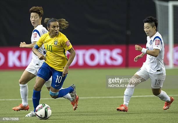Brazil's Marta is challenged by South Korea's Kim Hyeri and Kwon Hahnul during a Group E match at the 2015 FIFA Women's World Cup at the Olympic...