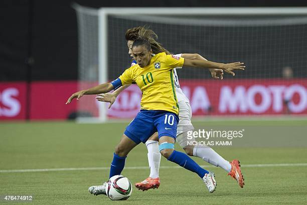 Brazil's Marta is challenged by South Korea's Kim Hyeri during a Group E match at the 2015 FIFA Women's World Cup at the Olympic Stadium in Montreal...