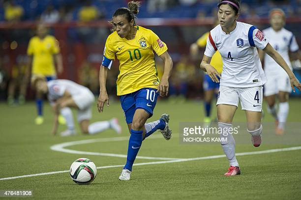 Brazil's Marta is chased by South Korea's Shim Seoyeon during a Group E match at the 2015 FIFA Women's World Cup at the Olympic Stadium in Montreal...