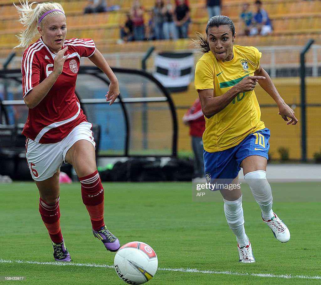 Brazil's Marta (R) is marked by Danish Line Sigvardsen Jensen during their City of Sao Paulo International Women´s Football Tournament match against Denmark at Pacaembu stadium in Sao Paulo, Brazil on December 16, 2012. Brazil, Denmark, Mexico and Portugal are participating in the tournament, which will culminate with the final on December 19. AFP PHOTO/Yasuyoshi CHIBA