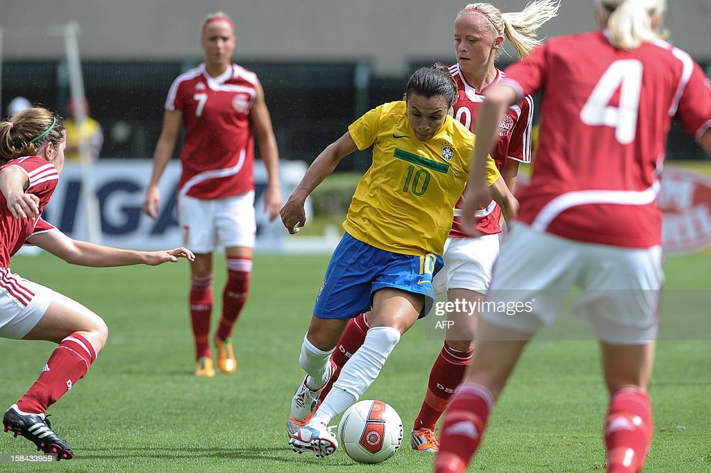 Brazil's Marta (C) is marked by Danish players during their City of Sao Paulo International Women´s Football Tournament match against Denmark at Pacaembu stadium in Sao Paulo, Brazil on December 16, 2012. Brazil, Denmark, Mexico and Portugal are participating in the tournament, which will culminate with the final on December 19. AFP PHOTO/Yasuyoshi CHIBA