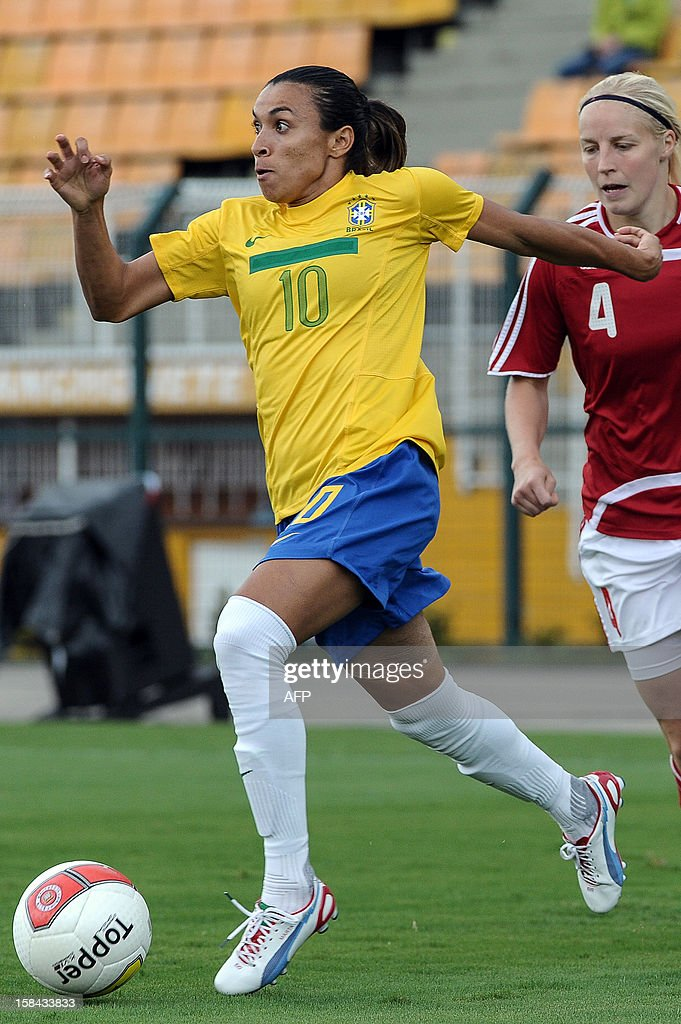 Brazil's Marta (L) is marked by Denmark´s Christina Orntoft during their City of Sao Paulo International Women´s Football Tournament match at Pacaembu stadium in Sao Paulo, Brazil on December 16, 2012. Brazil, Denmark, Mexico and Portugal are participating in the tournament, which will culminate with the final on December 19. AFP PHOTO/Yasuyoshi CHIBA