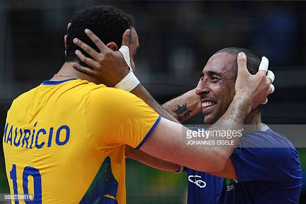 TOPSHOT Brazil's Mauricio Borges Almeida Silva and Brazil's Sergio Dutra Dos Santos celebrate after winning their men's Gold Medal volleyball match...