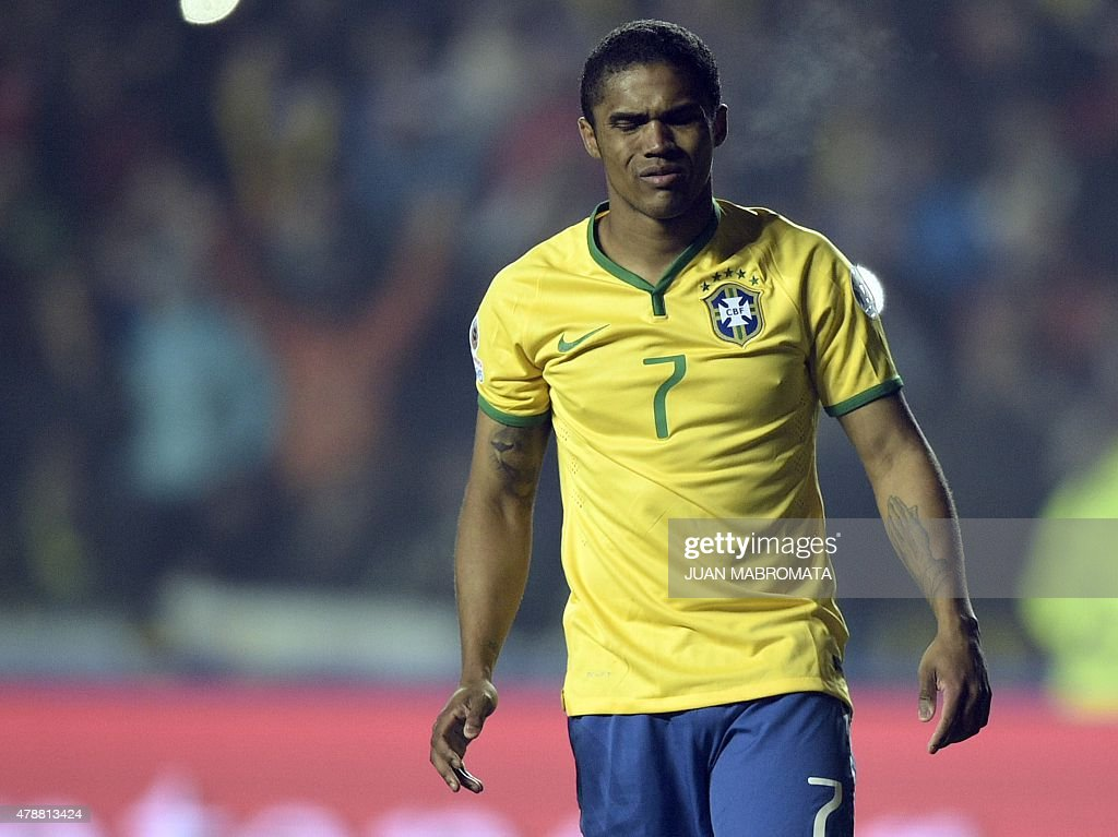Brazil's midfielder Douglas Costa gestures after missing his penalty in the shootout of their 2015 Copa America football championship quarterfinal...