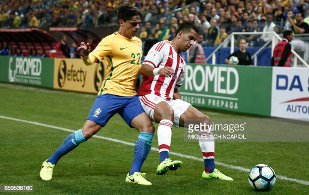 Brazil's midfielder Fagner vies for the bal with Paraguay's forward Cecilio Dominguez during their 2018 FIFA World Cup qualifier football match in...