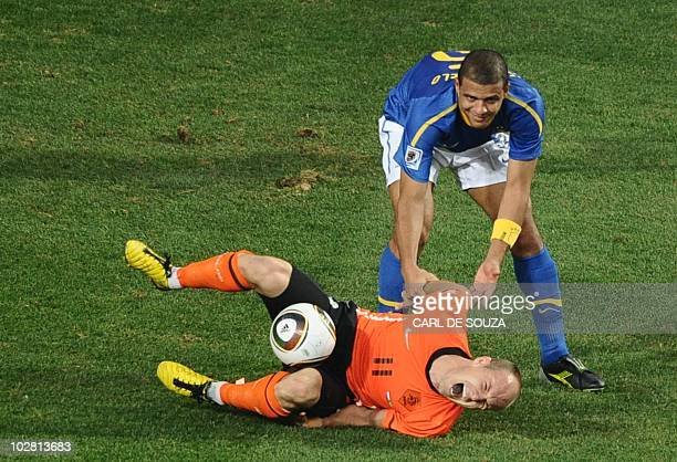 Brazil's midfielder Felipe Melo commits a foul on Netherlands' striker Arjen Robben and gets a red card during the 2010 World Cup quarter final...