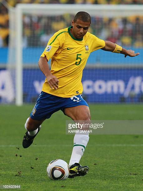 Brazil's midfielder Felipe Melo shoots the ball during the Group G first round 2010 World Cup football match Portugal vs Brazil on June 25 2010 at...