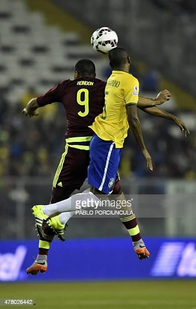 Brazil's midfielder Fernandinho and Venezuela's forward Jose Rondon jump for a header during their 2015 Copa America football championship match at...