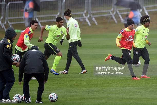 Brazil's midfielder Hernanes forward Hulk forward Bernard and midfielder Willian take part in a training session during the 2014 FIFA World Cup on...