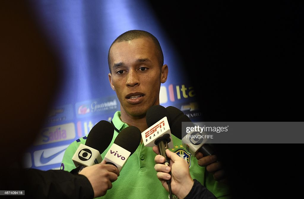 Brazil's midfielder Joao Miranda answers journalist questions during a press conference two days ahead of a friendly football match against France on...