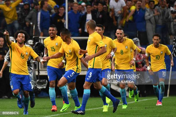 Brazil's midfielder Marcelo celebrates with teammates after scoring against Paraguay during their 2018 FIFA World Cup qualifier football match in Sao...