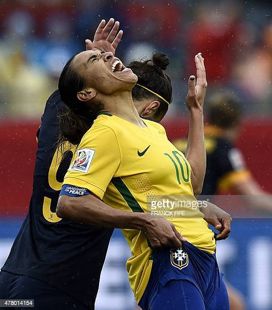Brazil's midfielder Marta reacts to her teams' loss to Australia in their 2015 FIFA Women's World Cup round of 16 match at Moncton Stadium in New...