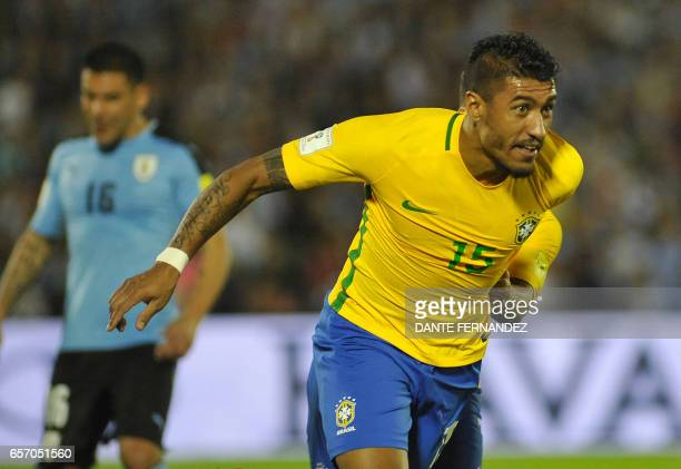 Brazil's midfielder Paulinho celebrates his second goal during their 2018 FIFA World Cup qualifier football match against Uruguay at the Centenario...