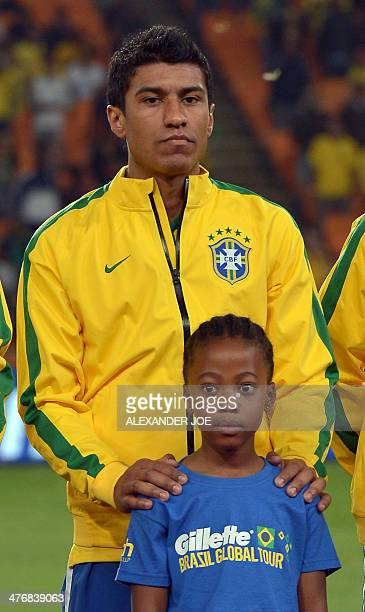 Brazil's midfielder Paulinho poses for a picture before a friendly football match between South Africa and Brazil at Soccer City stadium in Soweto...