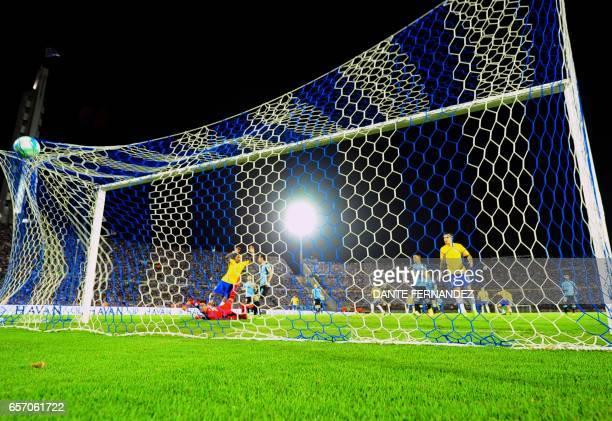 Brazil's midfielder Paulinho scores during their 2018 FIFA World Cup qualifier football match against Uruguay at the Centenario stadium in Montevideo...