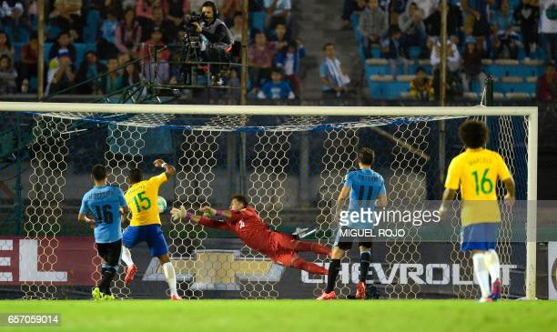 Brazil's midfielder Paulinho shoots a goal during their 2018 FIFA World Cup qualifier football match against Uruguay at the Centenario stadium in...