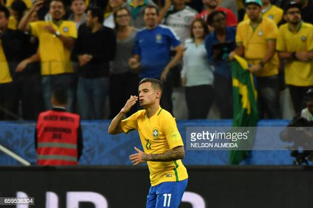 Brazil's midfielder Philippe Coutinho celebrates after scoring against Paraguay during their 2018 FIFA World Cup qualifier football match in Sao...