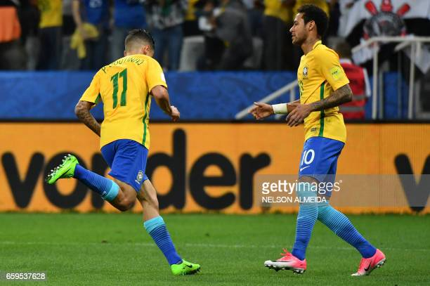 Brazil's midfielder Philippe Coutinho celebrates next to teammate Neymar after scoring against Paraguay during their 2018 FIFA World Cup qualifier...