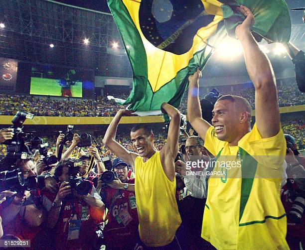 Brazil's midfielder Rivaldo celebrates with teammate Ronaldo after their team defeated Germany 20 in the final match of the 2002 FIFA World Cup Korea...