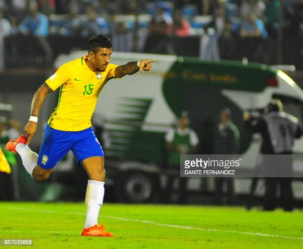 Brazil's midfieler Paulinho celebrates after scoring against Uruguay during their 2018 FIFA World Cup qualifier football match at the Centenario...