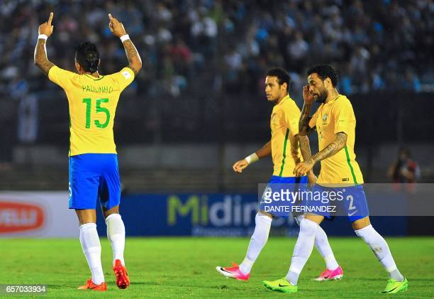 Brazil's midfieler Paulinho celebrates with teammates after scoring against Uruguay during their 2018 FIFA World Cup qualifier football match at the...
